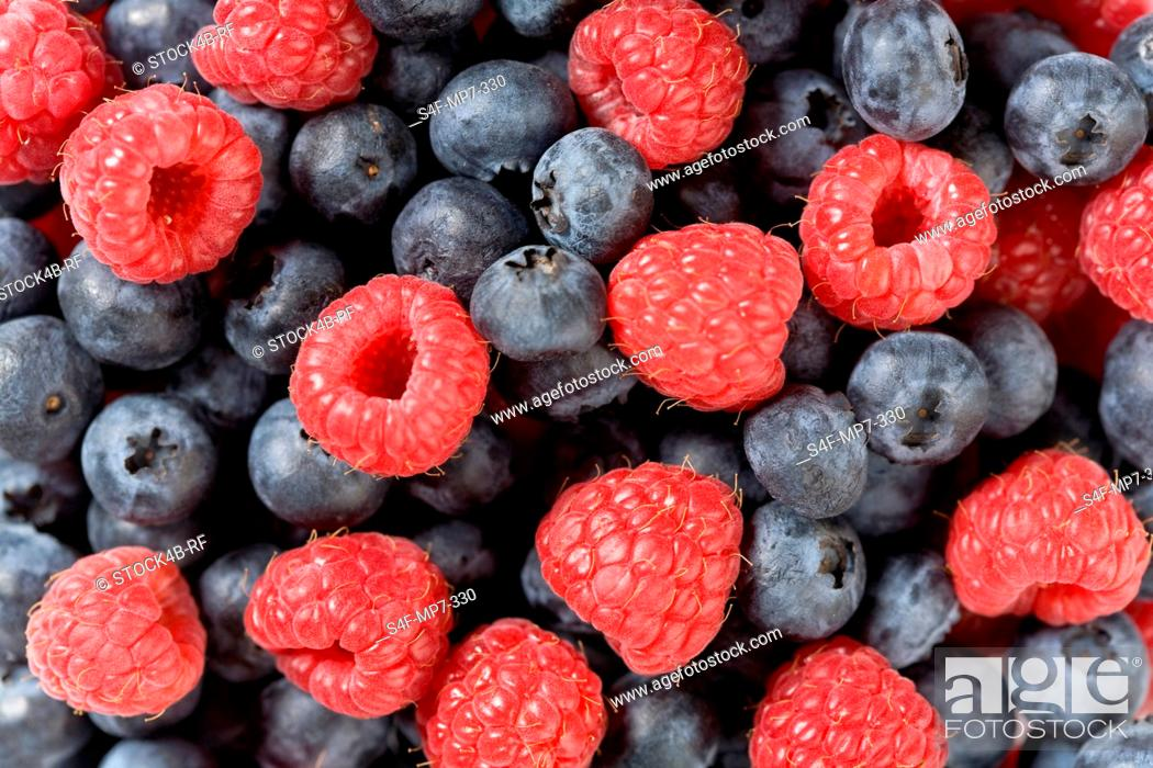 Stock Photo: Detail of blueberries and raspberries.