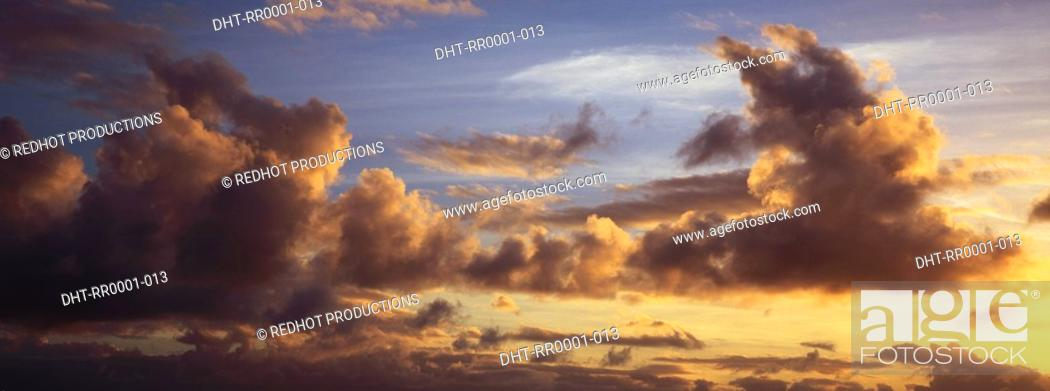 Stock Photo: Blue skies with dark clouds.