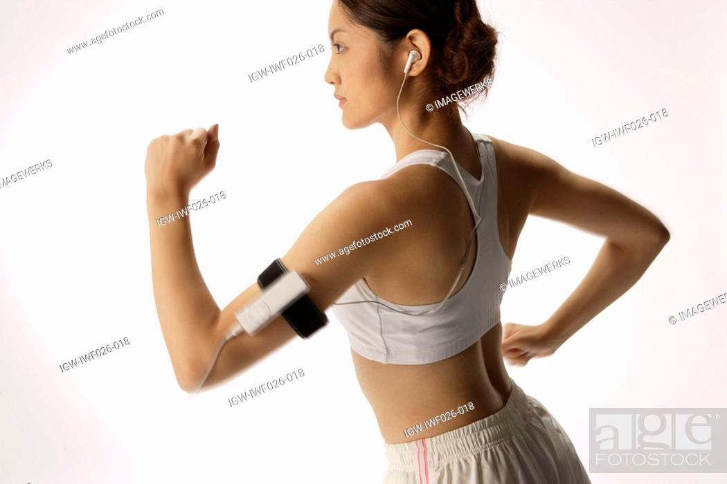 Stock Photo: Close-up of a young woman exercising.