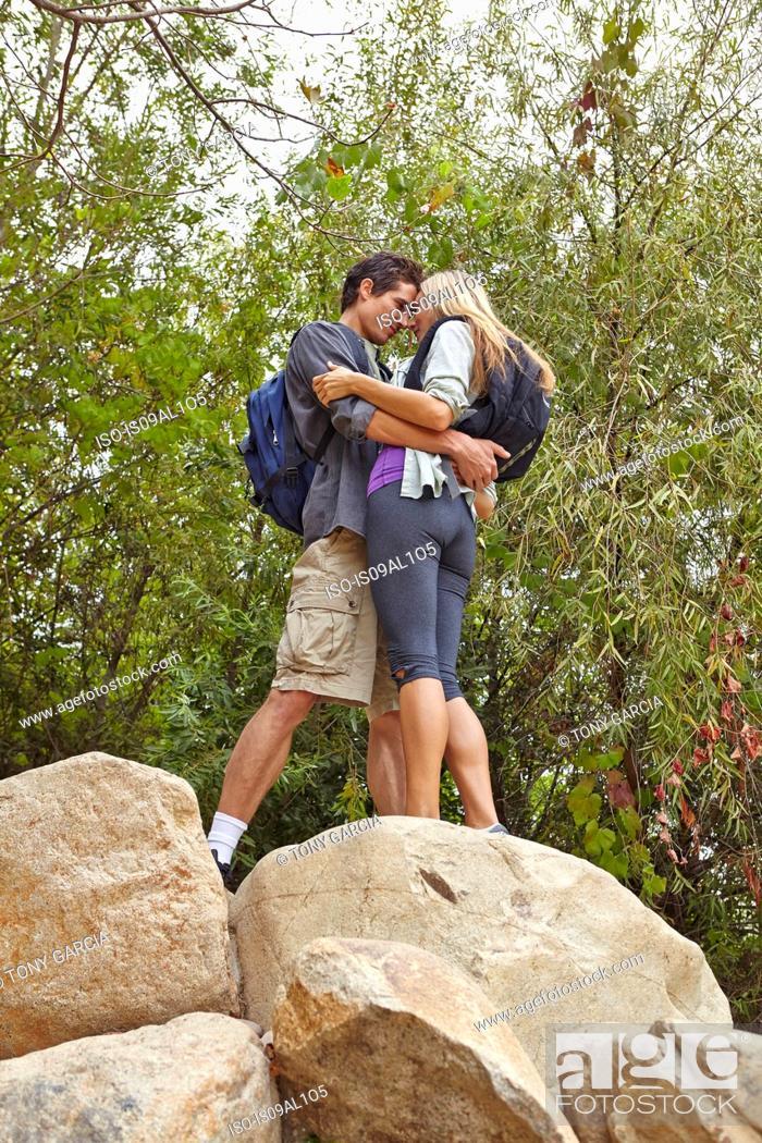 Stock Photo: Couple hugging on rock.
