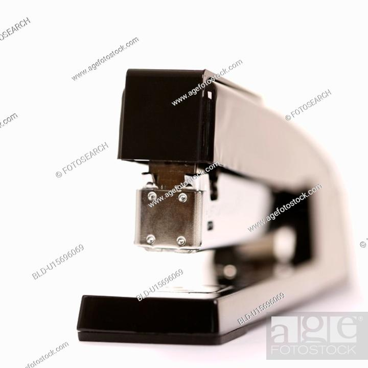 Stock Photo: Selective focus of black stapler on white background.