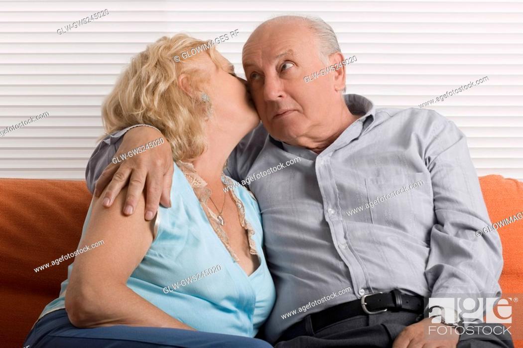 Stock Photo: Senior woman kissing a senior man.