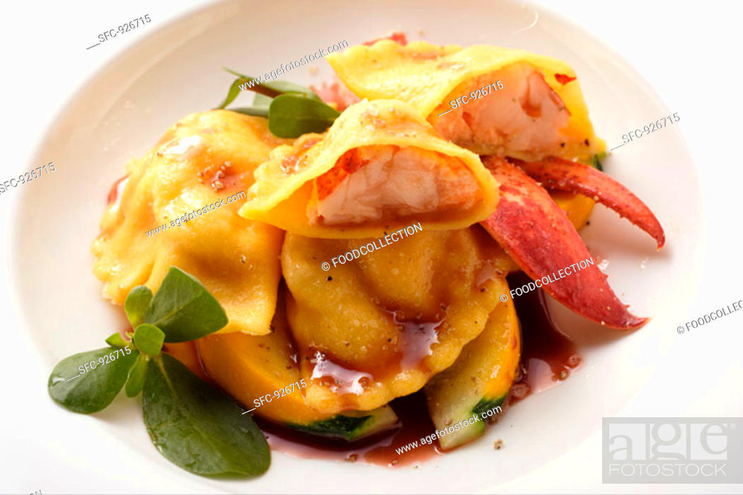 Stock Photo: Ravioli with lobster filling on courgettes.