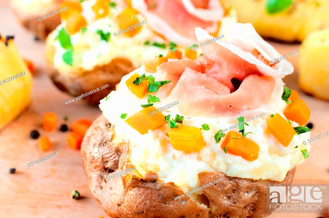 Stock Photo: Baked and stuffed potato with vegetables and cheese cream.