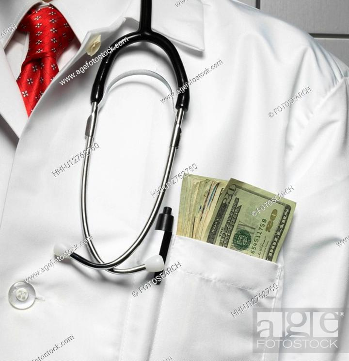 Stock Photo: Doctor with Money in Pocket.