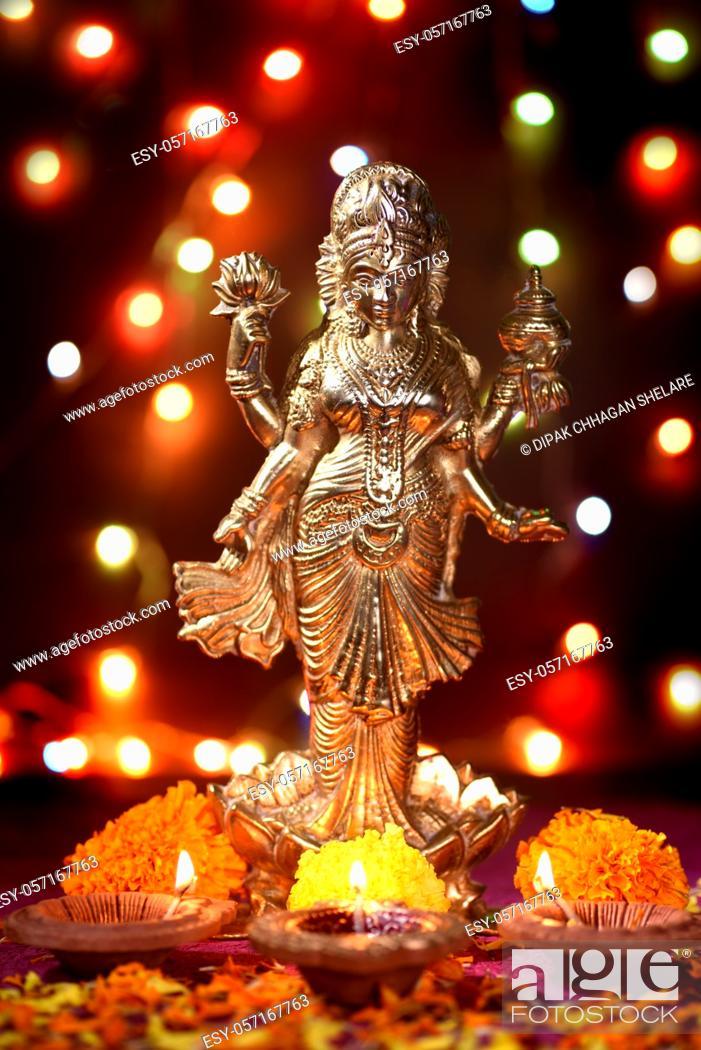 Stock Photo: Lakshmi - Hindu goddess , Goddess Lakshmi. Goddess Lakshmi during Diwali Celebration. Indian Hindu Light Festival called Diwali.