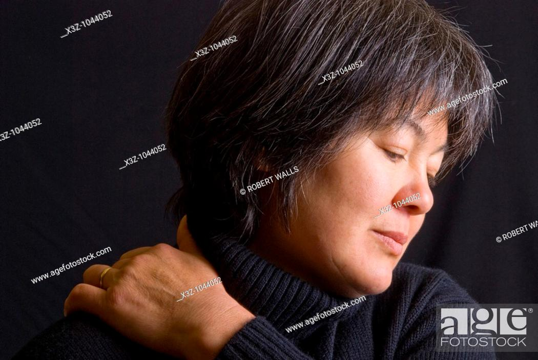 Stock Photo: Mature Eurasian woman with greying hair.
