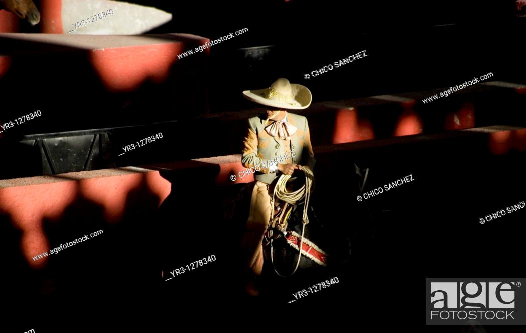 Stock Photo: A Mexican charro holds his lasso at the National Charro Championship in Pachuca, Hidalgo State, Mexico. Escaramuzas are similar to US rodeos.
