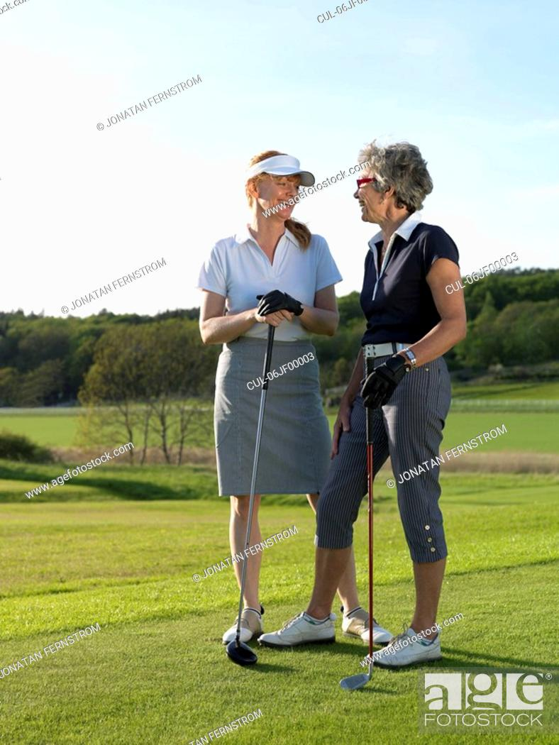 Stock Photo: Two women at tee.