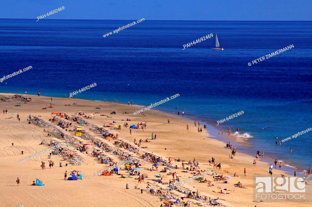 Stock Photo: Tourists enjoy the summerly weather on the beach near Morro Jable on the Canary Island Fuerteventura, Spain, 12 October 2015.