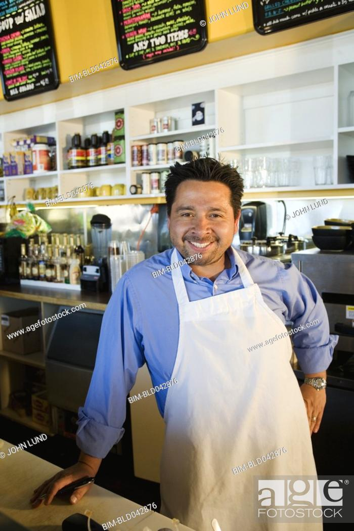 Stock Photo: Hispanic cafe owner at counter.