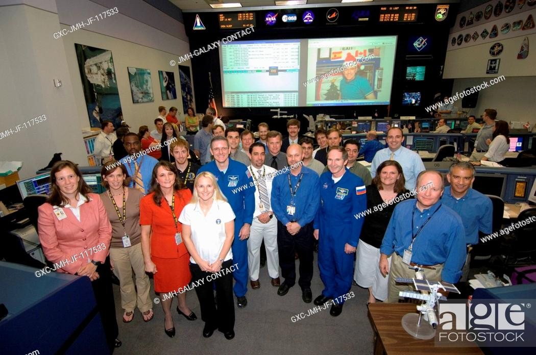 Stock Photo: The Expedition 12 crewmembers and flight controllers pose for a group portrait in the Station (Blue) Flight Control Room in Houston's Mission Control Center.
