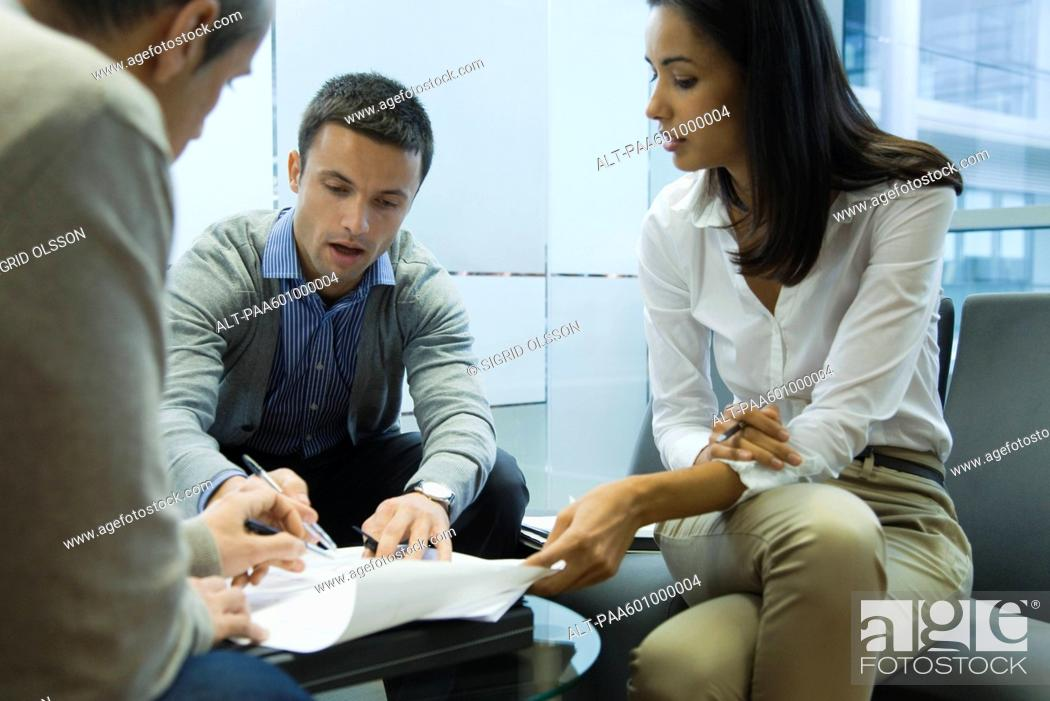 Stock Photo: Colleagues brainstorming during meeting.