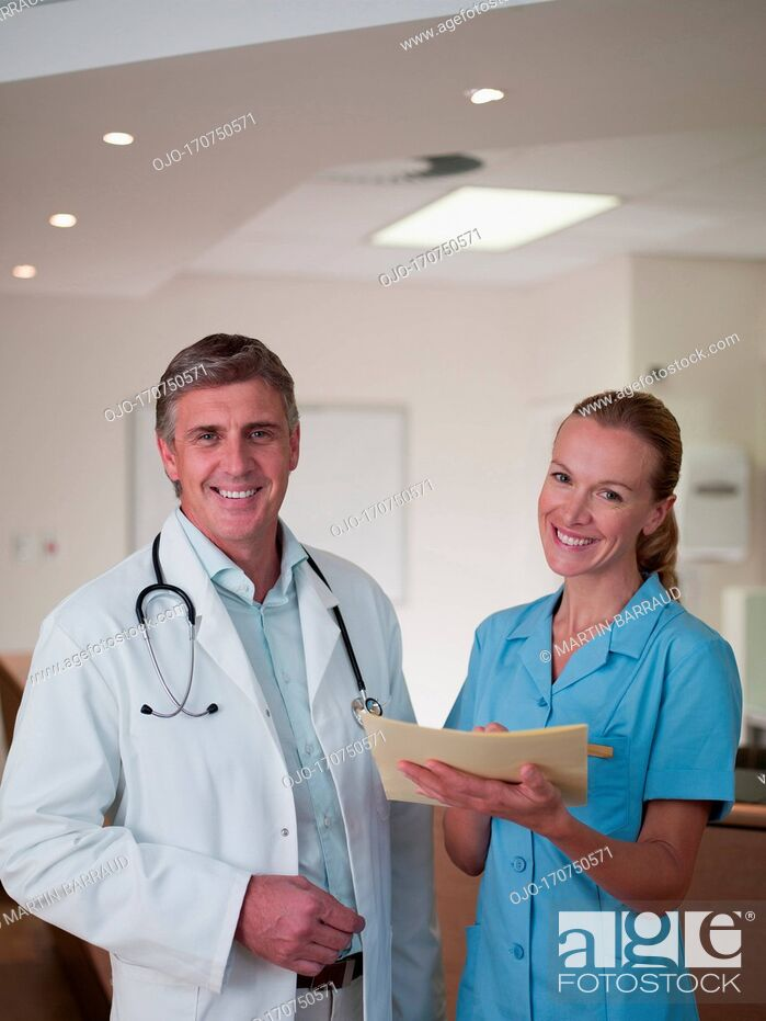 Stock Photo: Doctor and nurse reviewing medical chart.