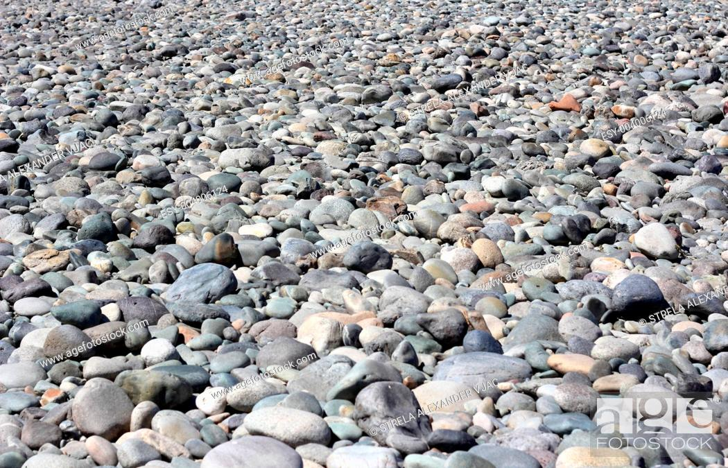 Stock Photo: The mound of stones on the bottom of dried-up river.