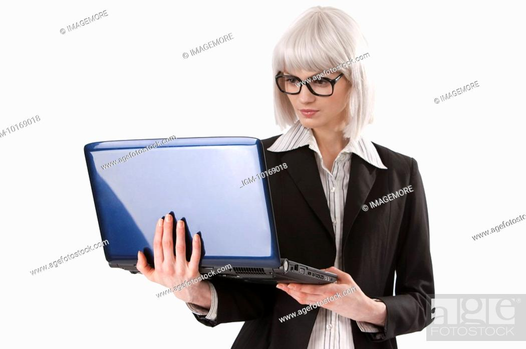 Stock Photo: Young businesswoman using a laptop being held in arm.