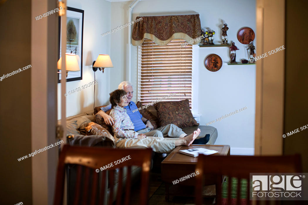 Stock Photo: Senior couple watching tv at home.
