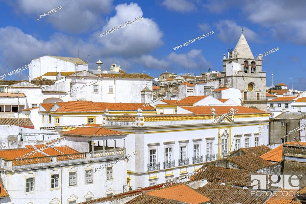 Stock Photo: Cityscape with the Clock tower of the church of Our Lady of the Assumption, Garrison Border Town of Elvas and its Fortifications, Portalegre District.