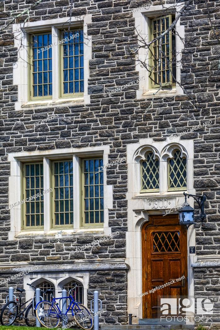 Stock Photo: Princeton University Patton Hall No 9 - Exterior view of of windows, lamp, door, stonework and students bicycles of the now known as Patton-Wright Hall.