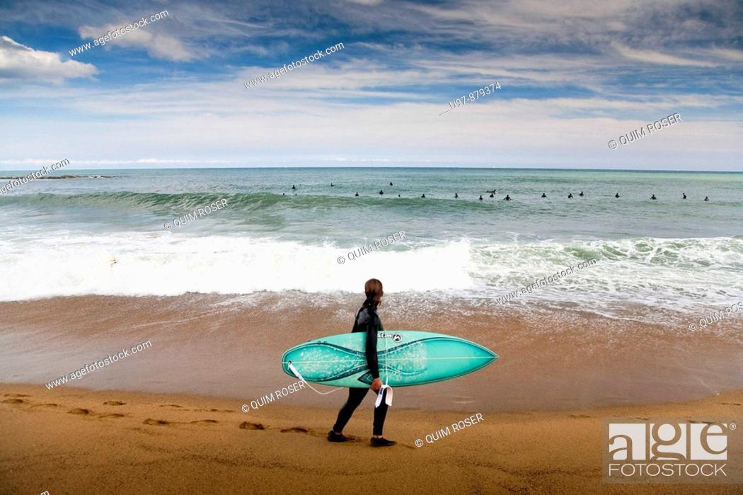 Stock Photo: Surfing in La Barcelonata Beach, Barcelona, Catalonia, Spain.