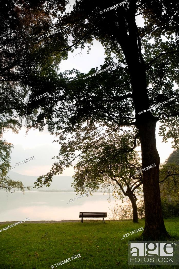 Stock Photo: Bench on Kochelsee lake shore, Bavaria, Germany.