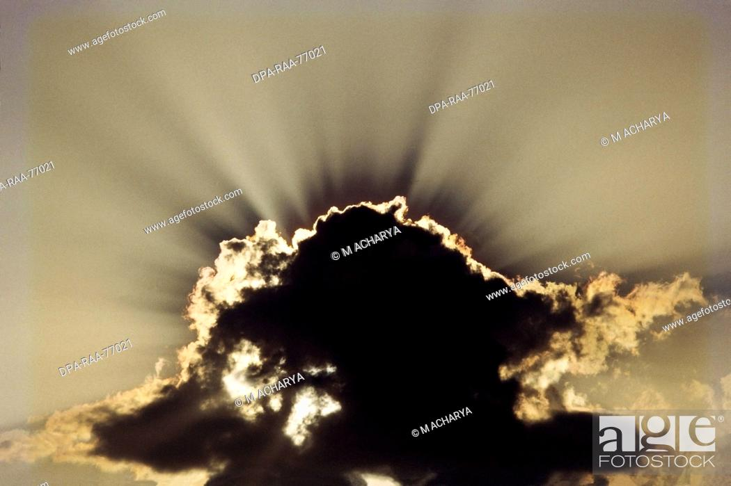 af28c1bb4c6c8 Stock Photo - sky Bright sun rays shining from grey cloud with silver  lining tropical rain