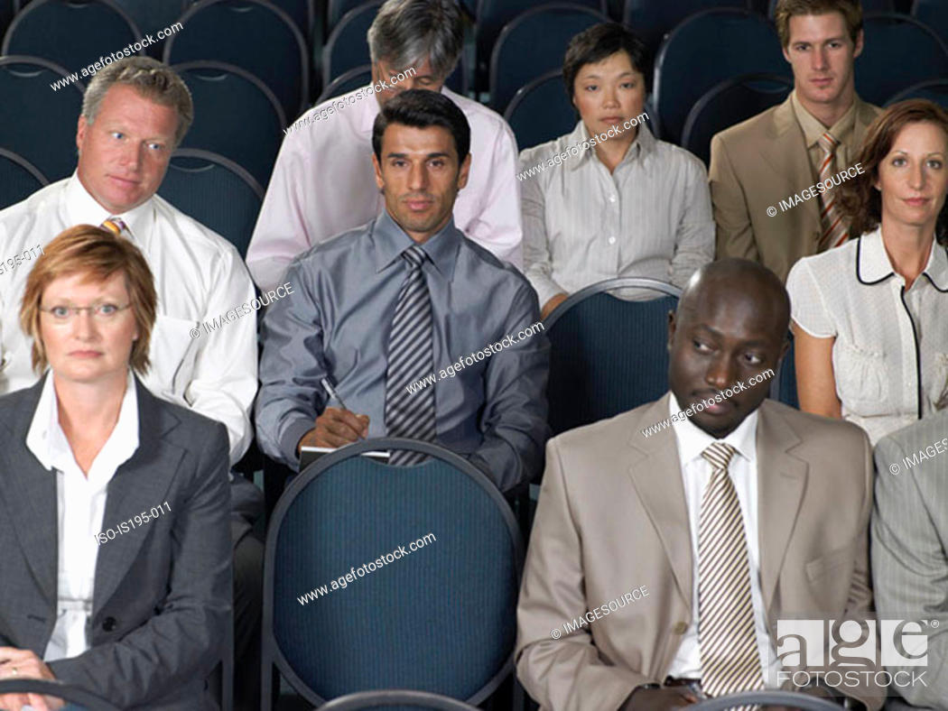 Stock Photo: Office workers listening to presentation.