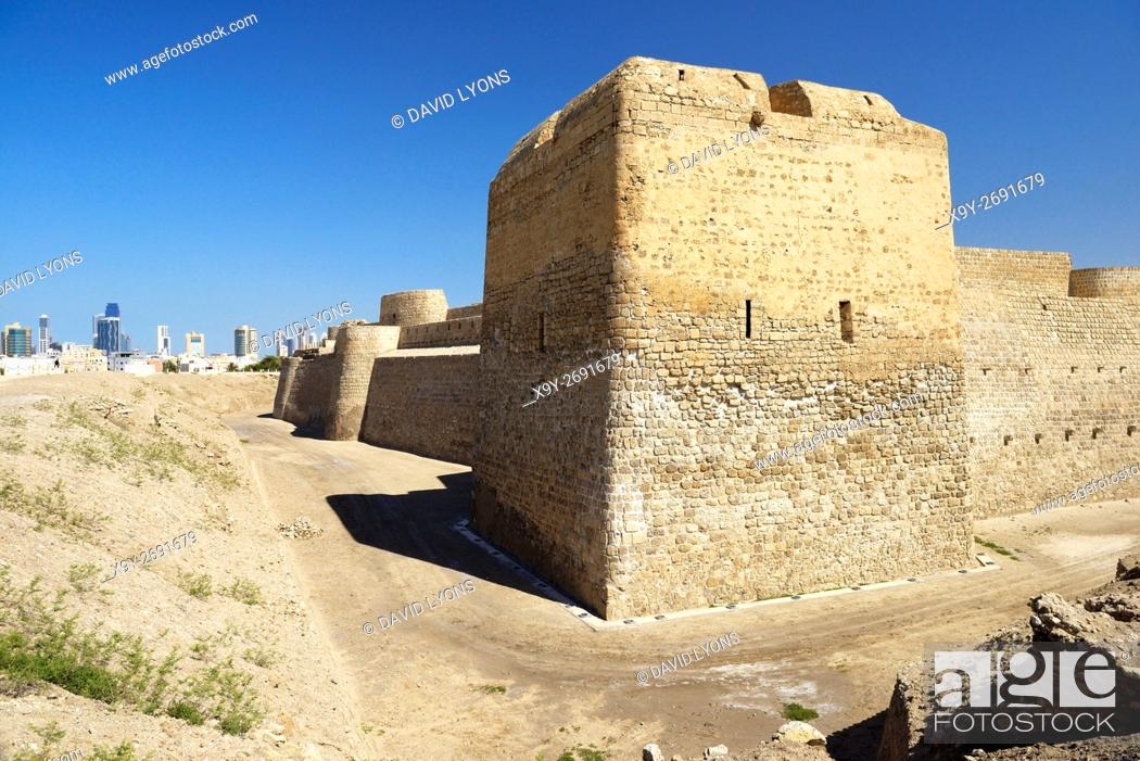 Stock Photo: Bahrain Fort dates from 2300 BC Copper and Bronze Ages. Once capital of Dilmun civilization. Looking west to Manama cityscape.