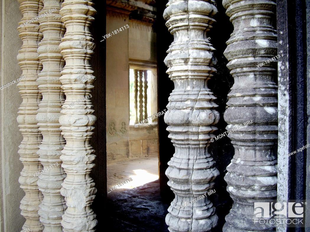 Stock Photo: Balustered windows at Angkor Wat, Cambodia.