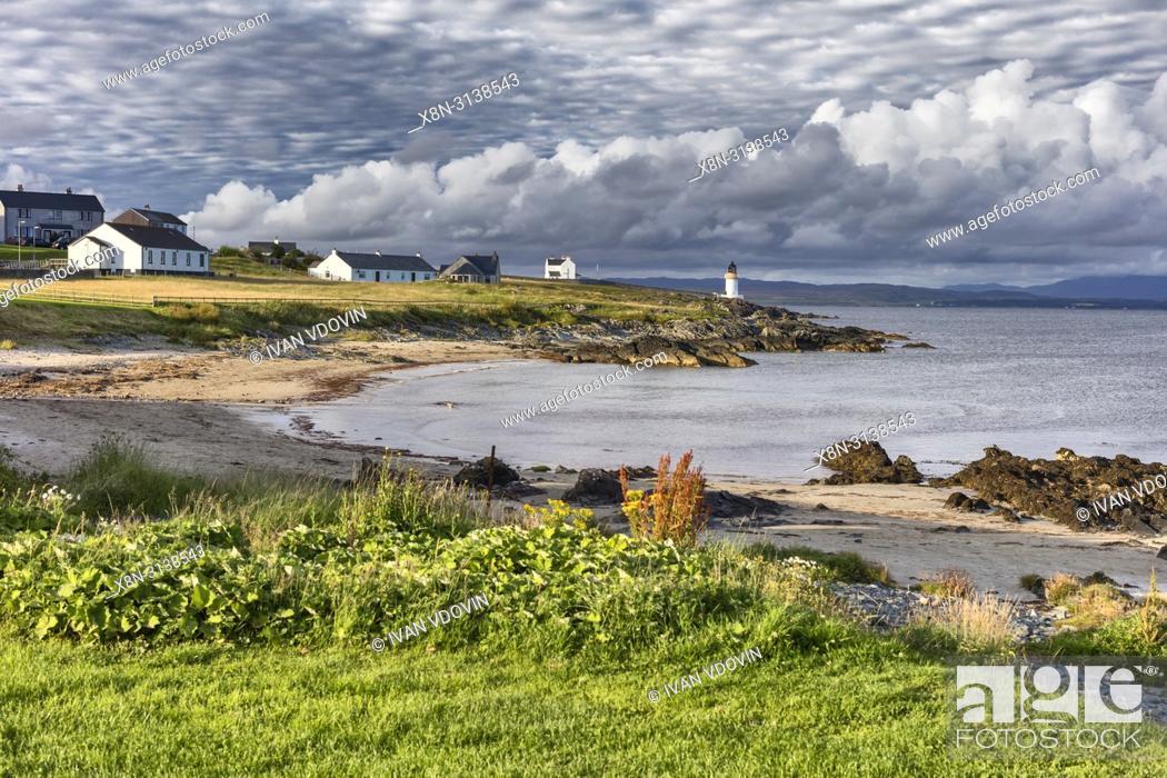 Stock Photo: Sea coast with lighthouse, Port Charlotte, Islay, Inner Hebrides, Argyll, Scotland, UK.