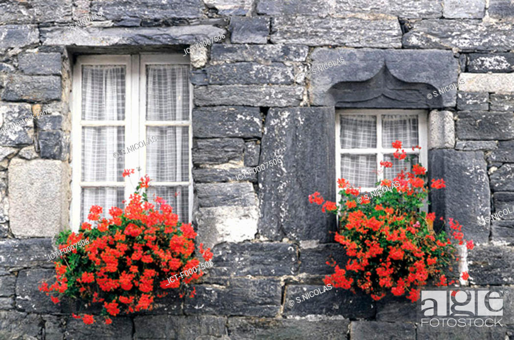 Stock Photo: France, Brittany, Flowered windows.