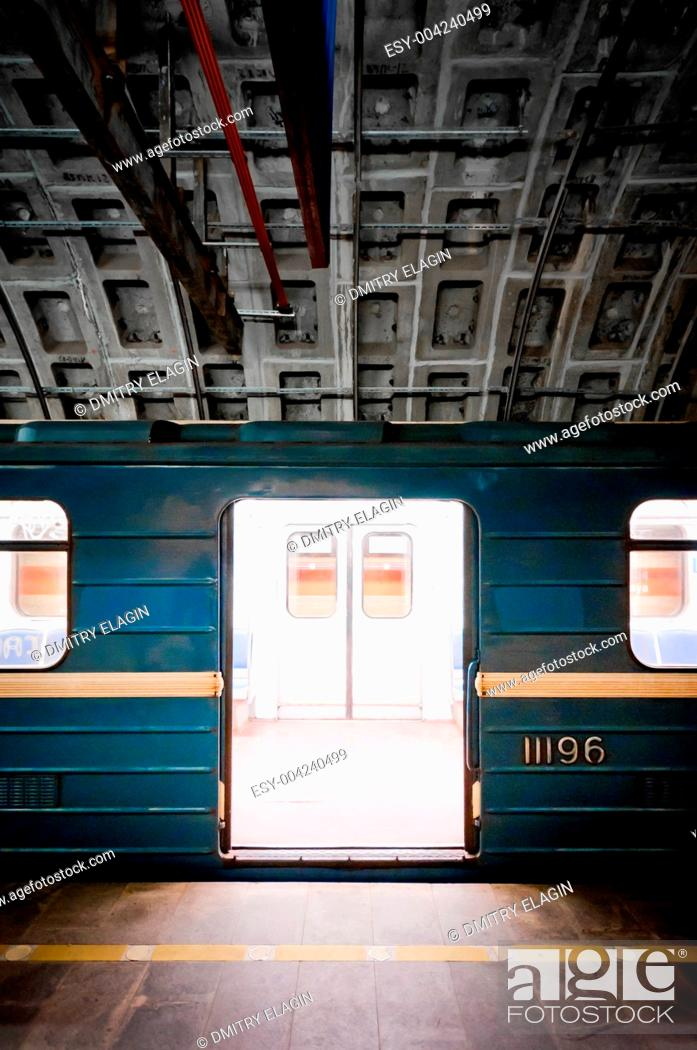 Stock Photo: Subway train in dark tunnel.