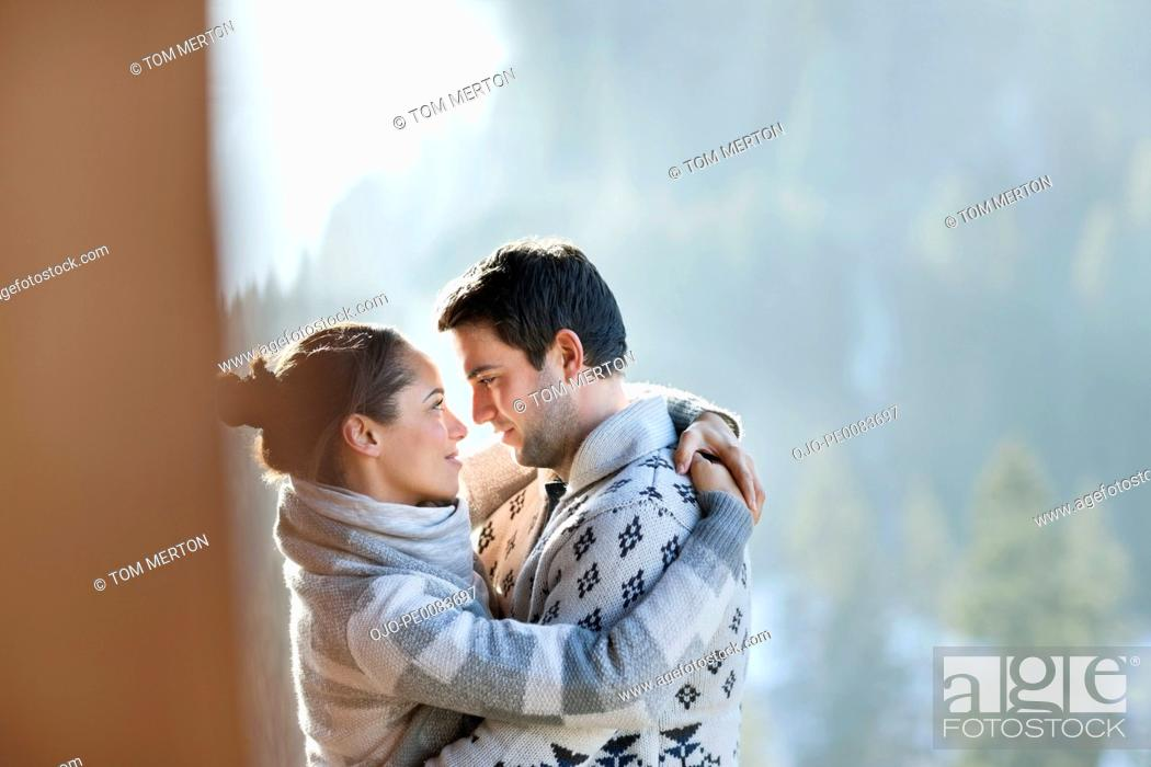 Stock Photo: Couple hugging face to face outdoors.