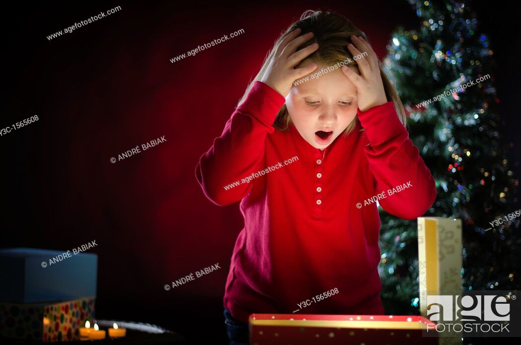 Stock Photo: Wow - it's what I have wished for  Young girl can't believe she actually got this Christmas present.