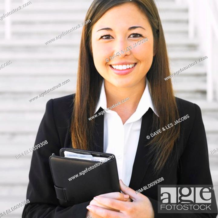 Stock Photo: Close up of Mixed Race businesswoman smiling.