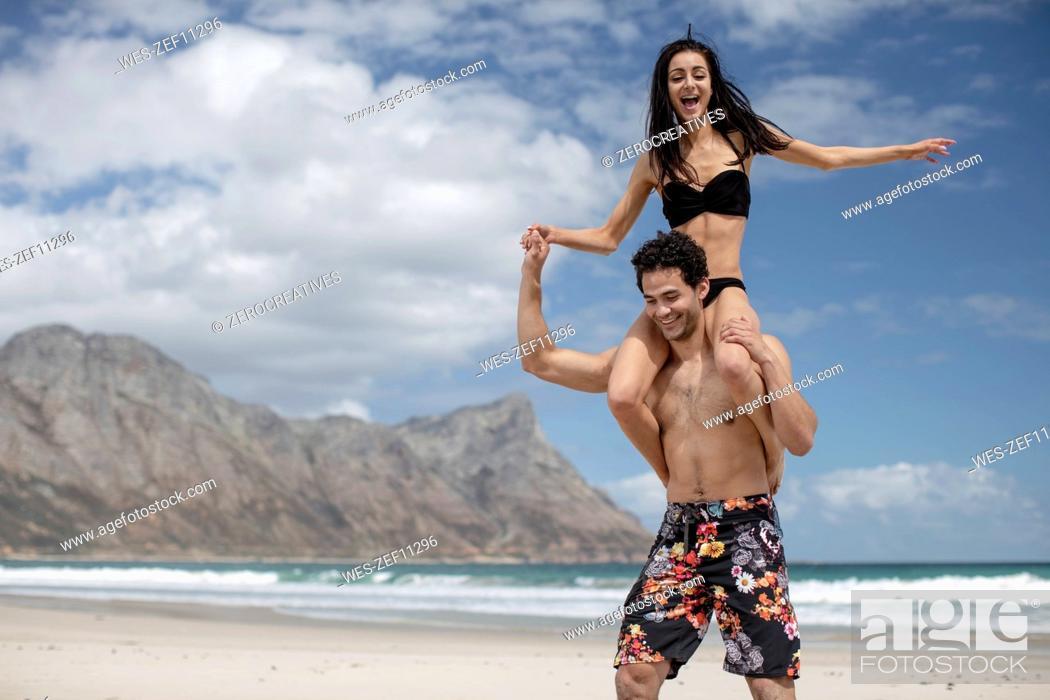 Stock Photo: Young couple on the beach having fun.
