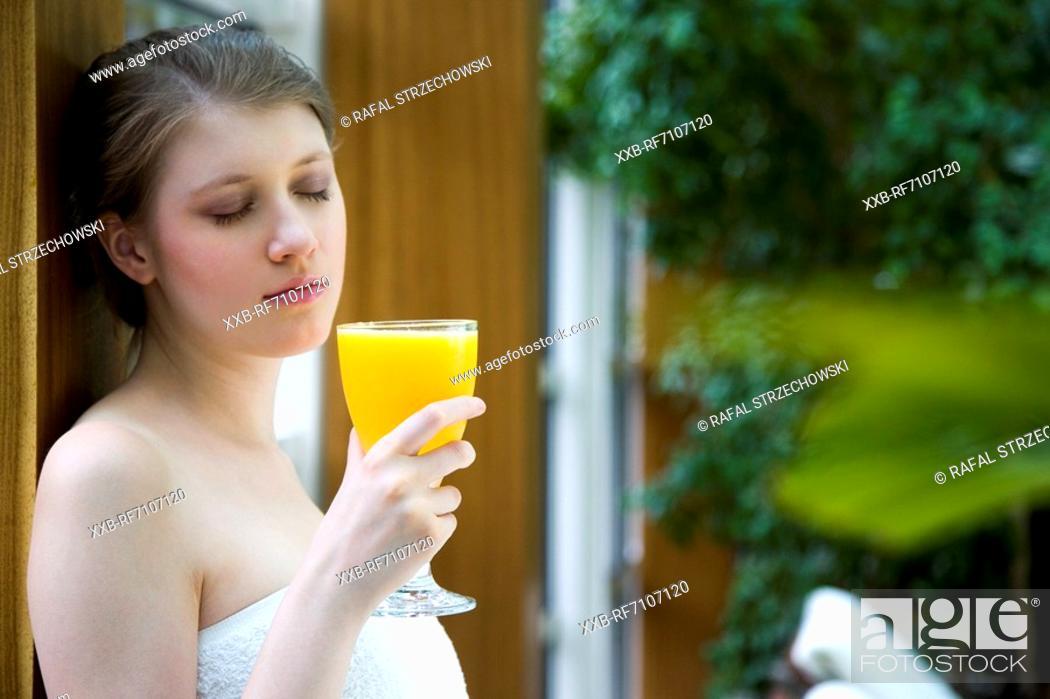 Stock Photo: Woman drinking orange juice.