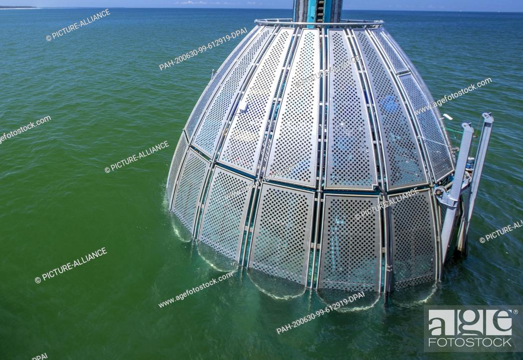 Stock Photo: 24 June 2020, Mecklenburg-Western Pomerania, Zingst: With the diving gondola at the Zingst pier, holidaymakers can observe the underwater world in the Baltic.