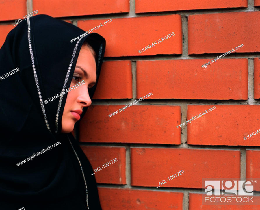 Stock Photo: Pensive woman leaning against a wall.