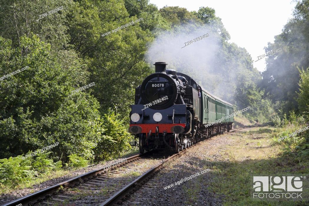 Stock Photo: Class 4MT Standard Tank 80078 heads a train on the Spa Valley Railway , Kent.