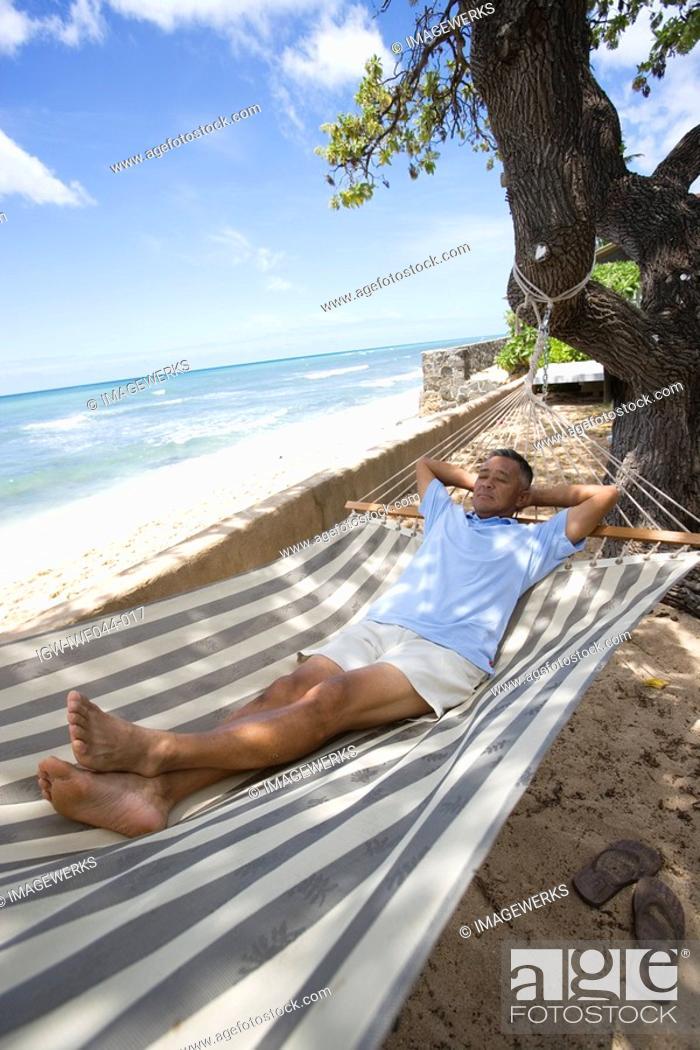 Stock Photo: Mature man lying on hammock.