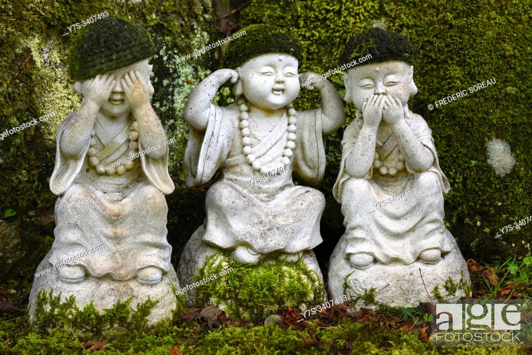 Stock Photo: Group of three stone statues of buddhistic monks holding their eyes, ears and mouth to see, speak and hear nothing of evil, Miyajima island, Japan, Asia.