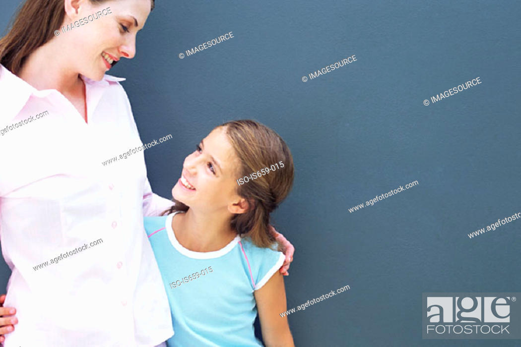 Stock Photo: Girl looking up at mother.