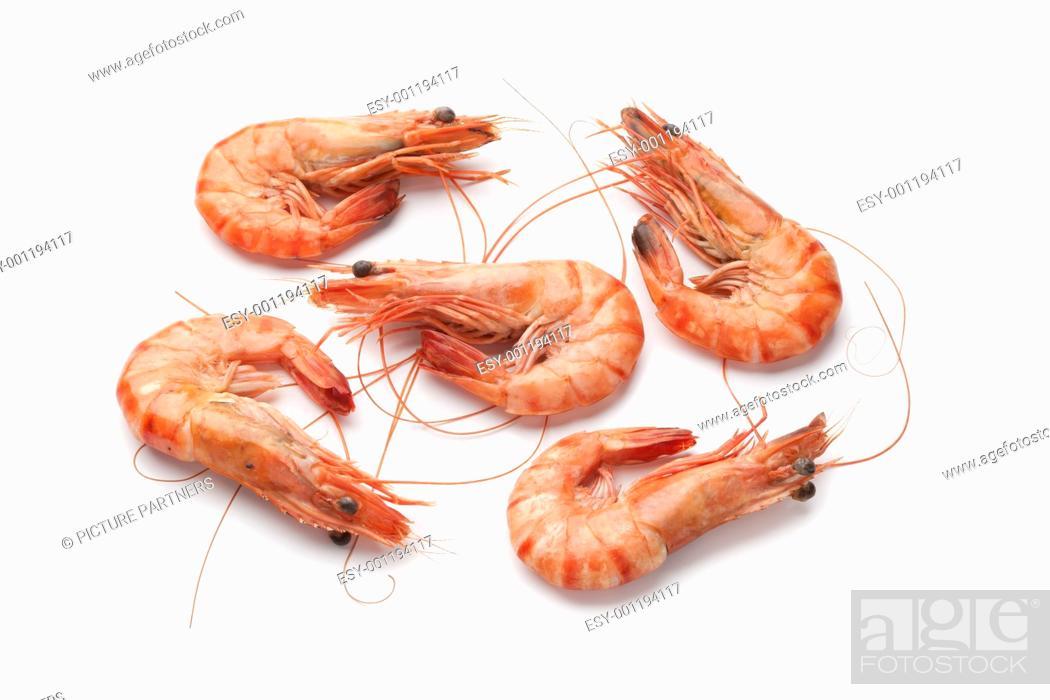 Stock Photo: Whole cooked shrimps on white background.