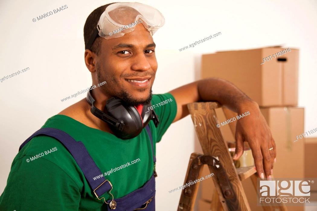 Stock Photo: A man preparing to do some renovating, moving house.
