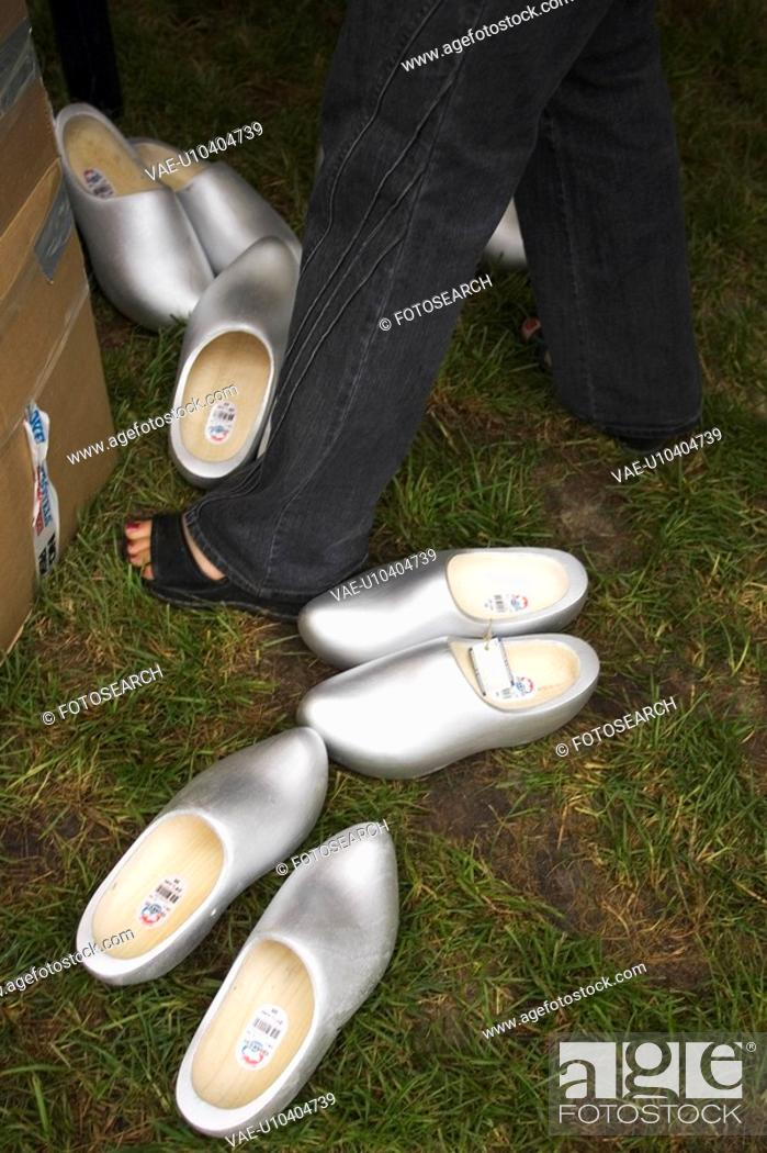 Stock Photo: Cardboard Box, Casual Clothing, Clogs, Close-Up, Grass.