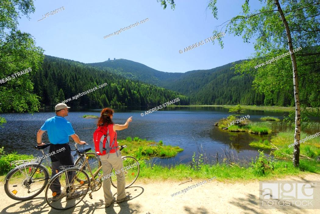 Stock Photo: Cyclists near Lake Small Arber, Great Arber in background, Bavarian Forest National Park, Lower Bavaria, Bavaria, Germany.