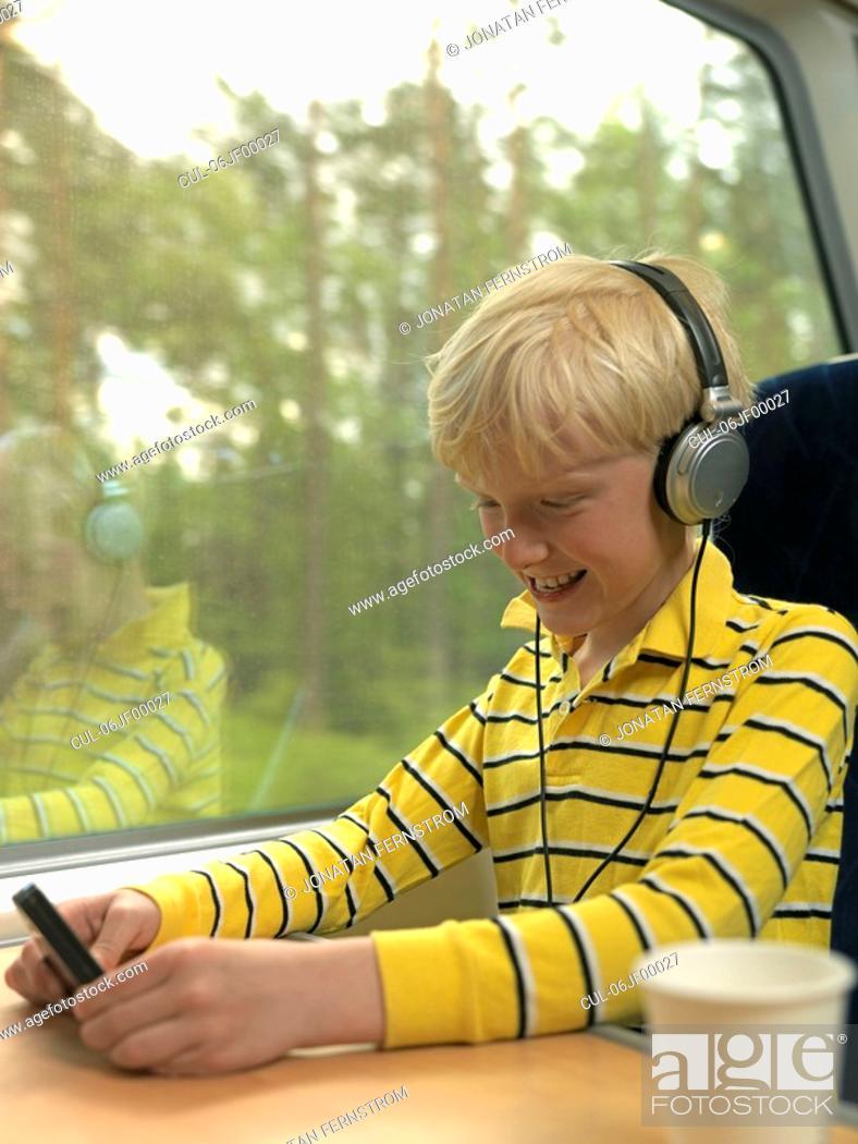 Stock Photo: Boy on train.