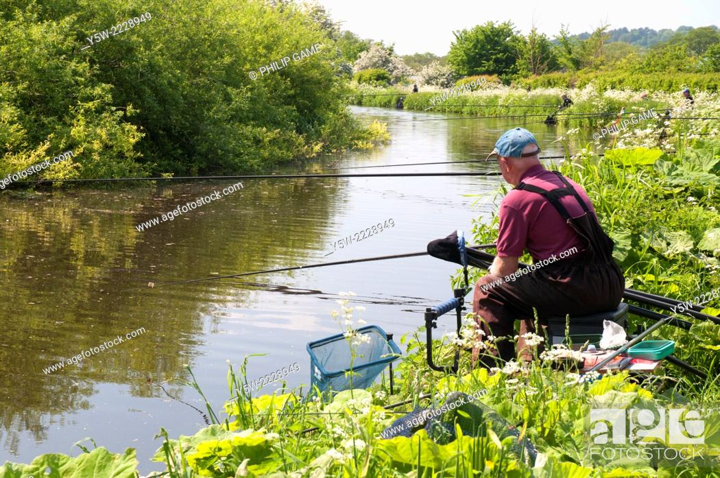 Stock Photo: Anglers on the Staffordshire and Worcestershire Canal in the Black Country, England.
