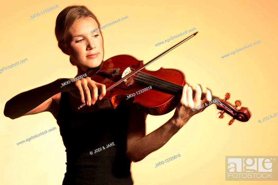 Stock Photo: Woman Playing Viola.